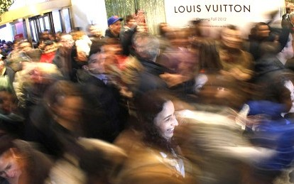 Customers rush into the Macy's store during Thanksgiving Day holiday in New York